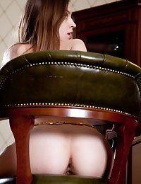 Tall diminutive titted nude gal posing