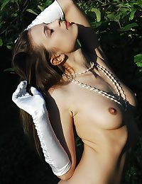 Stunning honey with hairless slit posing unconcealed in the garden