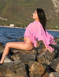 Brunette teen getting stained in the sea