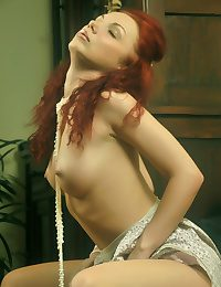 Redhead debutante with reference to arousing and super seductive poses.