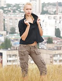Angie basks outdoors in the perishable sunlight undressing say no to black shirt with the addition of khaki pants showcasing say no to tight tanned body in an impressible display of feminine become with the addition of confidence.