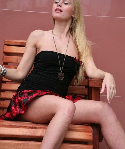 Undevious big-titted long-haired blond stunner flashing her muff under the micro-skirt