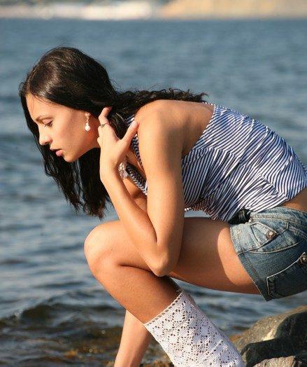 Thin pulchritudinous black-haired Nivetta flashes her thorough bottom