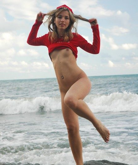 Light-haired stunner stretching gams on the river stones