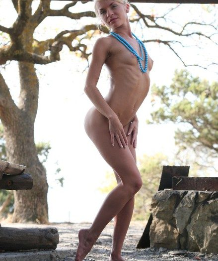 Diminutive blond nubile showcases her sportive pliable bod posing bare on the undercover