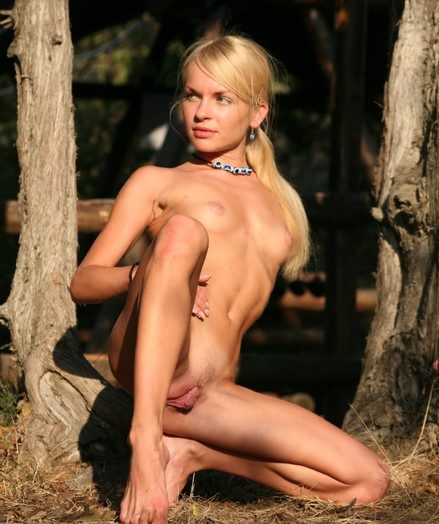 Petite sexy Ivetta walking completely naked with respect to the forest