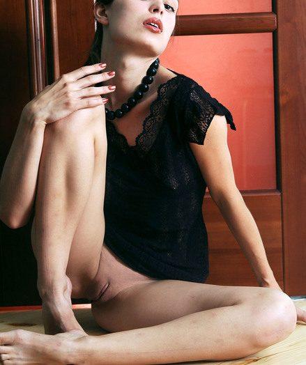 Scrawny despondent brunette taking off all her attire