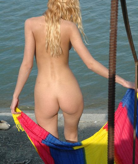 Spectacular platinum-blonde glorious teenager stunner posing on the sea-shore
