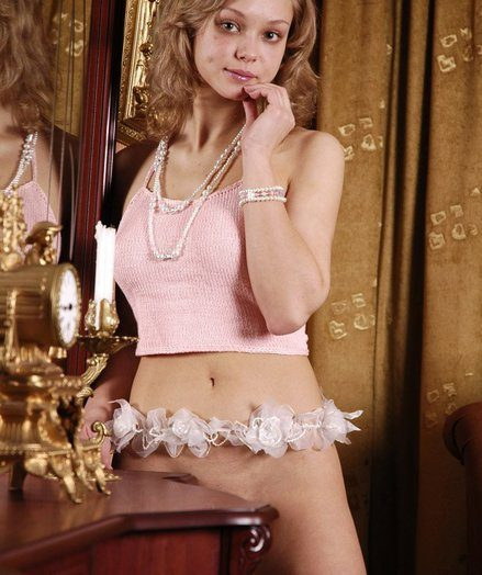 Fantastic curly platinum-blonde honey Irka posing bottomless