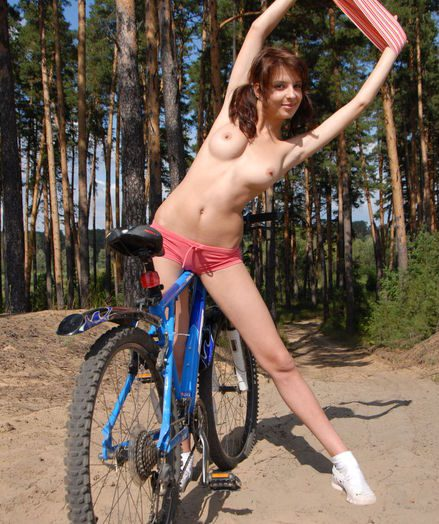 Demoiselle unclothes outdoors