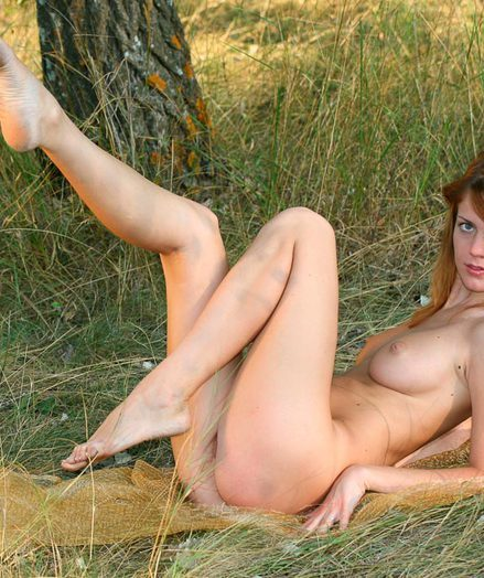 Nude gymnast outdoors