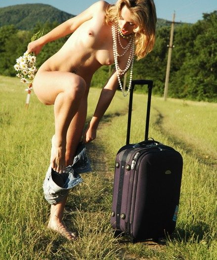 Naked blonde girl having sport posing outdoors